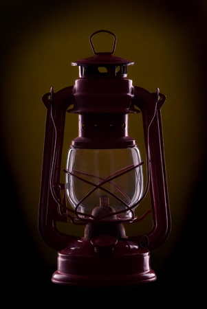 kerosene lamp: Red oil lamp on a dark Yellow background Stock Photo