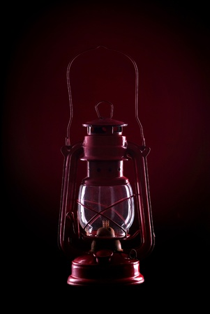 red oil lamp: Red oil lamp on a dark red background Stock Photo