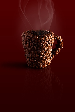 steaming: mug in the coffee beans with steam on a brown background Stock Photo