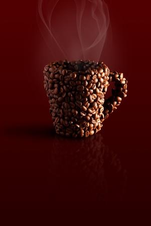 cafe colombiano: taza de los granos de caf� con vapor en un fondo marr�n Foto de archivo