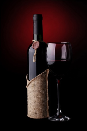 Wine Still Life with a dark red background