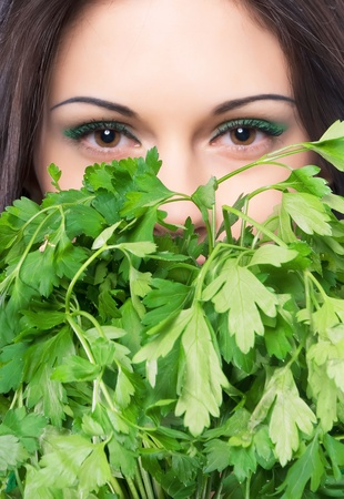 close-up portrait of a beautiful young girl covered with parsley
