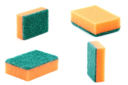 household objects equipment: orange kitchen sponge isolated on a white background Stock Photo