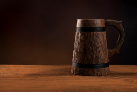 Mug of fresh beer on a wooden table  Stock Photo - 16434815