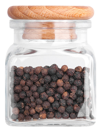 Black pepper in a glass bottle. Isolated on white background