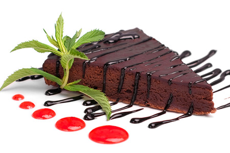 Chocolate cake with chocolate cream and mint leaves