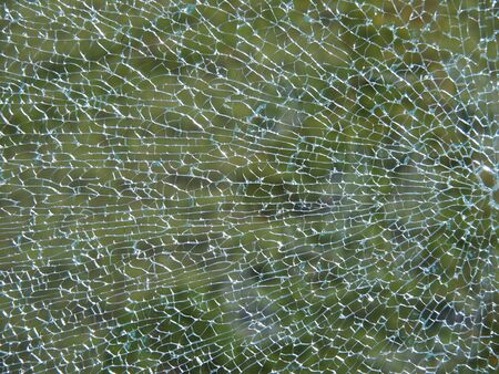 Close up of a broken glass pane photo