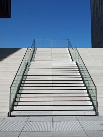 Stairway out of concrete in bright sunshine