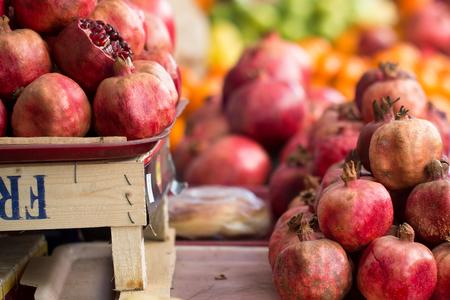 pomergranate: Close-up ripe juicy pomergranate at fruit marketplace