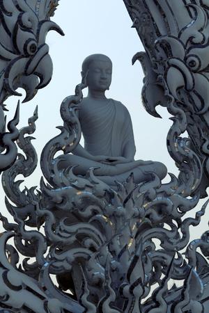 moksha: White sculpture of meditating Buddha in Wat Rong Khun