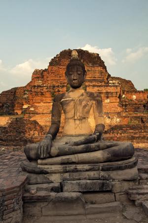 moksha: Ancient sculpture of meditating Buddha in Ayutthaya