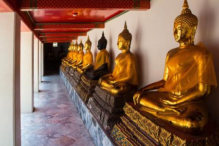 moksha: Golden Buddha sculptures in Wat Pho, Bangkok, Thailand