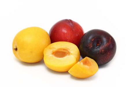 Group of plums with various colours isolated on white background