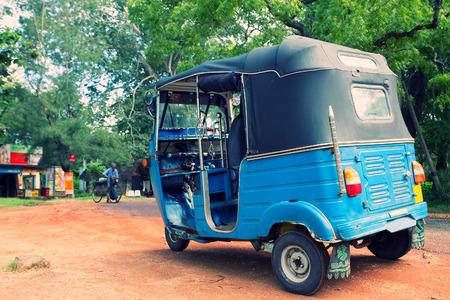 Asian taxi (tuc-tuc, tuk-tuk, tuck-tuck, tri-wheel, tricycle)