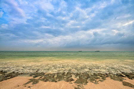 littoral: Tropical beach during the tide with sand, sky and littoral zone Stock Photo