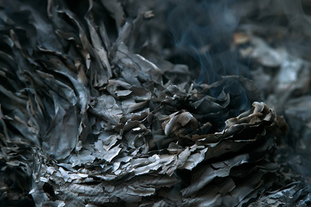 Burnig paper pages and remaining ashes and ember