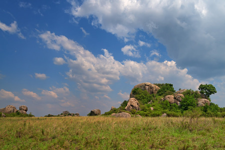 else: Inselberg or else monadnock amidst African savanna