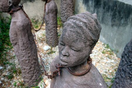 Sculpture of slaves dedicated to victims of slavery in Stone Town of Zanzibar Stockfoto
