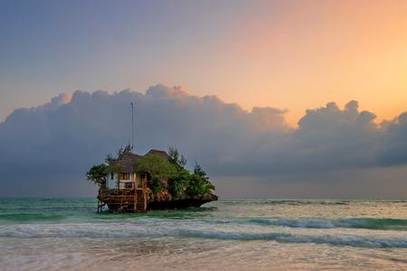 Rock romantic restaurant in Indian ocean near Zanzibar coastline