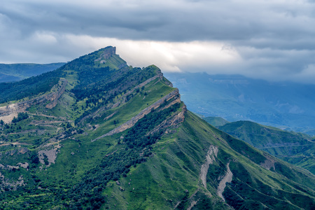 dagestan: Scenic mountain landscape with aules and dramatic sky Stock Photo