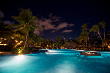 PUNTA CANA, DOMINICAN REPUBLIC - CIRCA OCTOBER 2015: Night scenic view of five stars all inclusive hotel Barcelo Bavaro Palace in Punta Cana, October 2015. Punta Cana is world famous tropical resort.