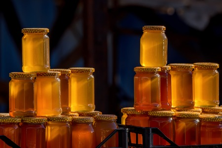 sorts: Pots with different sorts of honey in Russian marketplace Stock Photo