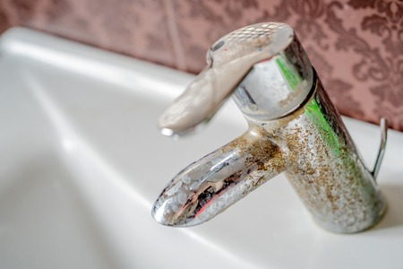 calcium: Hard water calcium deposit on chrome tap Stock Photo
