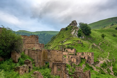 dagestan: Abandoned village Gamsutl in Dagestan. Scenic landscape with ruins of lost city in mountains Stock Photo