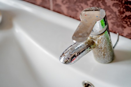 Hard water calcium deposit on chrome tap Stock Photo