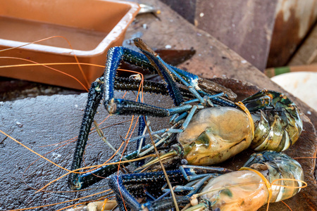 Raw giant freshwater prawn at morning market in Asia