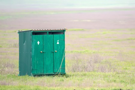 outhouse: Outhouse in summer countryside Stock Photo