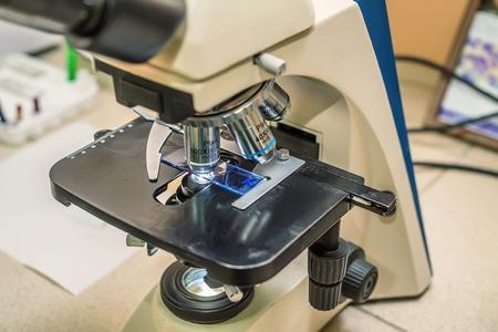 Closeup of objective lens microscope in laboratory Stock Photo