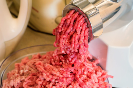 Close-up of minced meat coming out from grinder Zdjęcie Seryjne