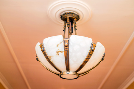 Magnificent baroque chandelier on the ceiling Stock Photo