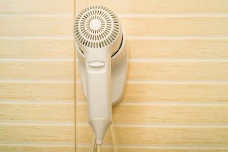 hairdryer: Beige hairdryer in bathroom