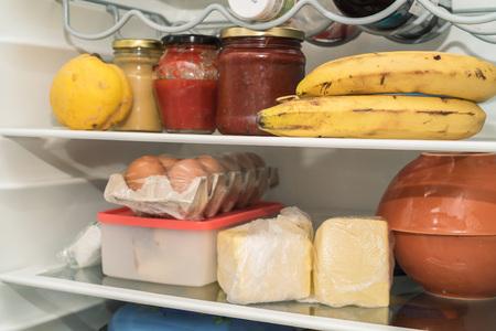 Open fridge with usual food Stock Photo