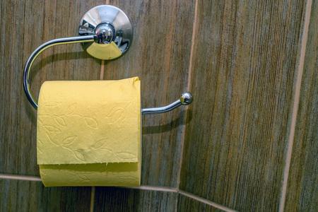 wood floor: Roll of toilet paper