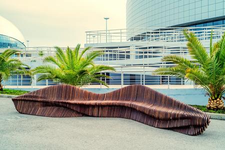 Modern design bench in park zone
