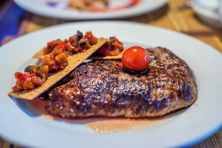 Grilled beef with tomato and bruschetta