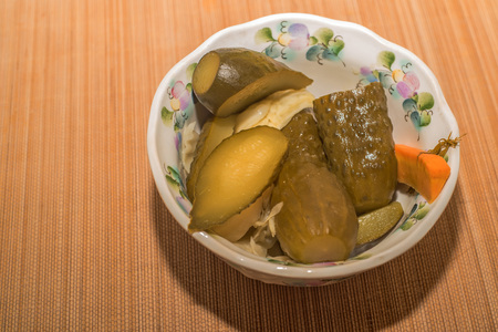 marinated gherkins: Bowl of chopped pickled gherkins