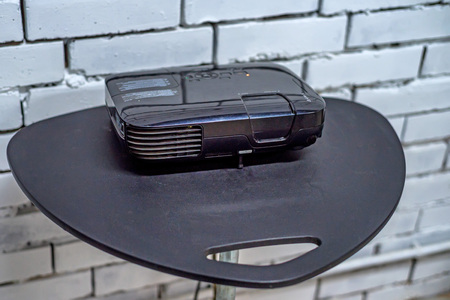 work path: Close up modern projector on table