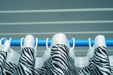 freaky: Close up top of shower curtain with zebra pattern