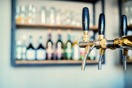 Chrome beer taps in modern bar Foto de archivo