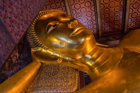 Golden lying buddha in Wat Pho in Thailand Stock Photo