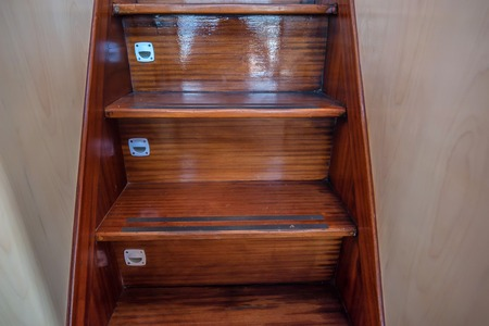 Wooden staircase on modern yacht Stock Photo