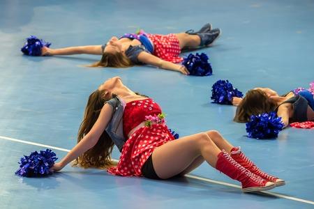 entertaining: Blurred cheerleaders entertaining audience