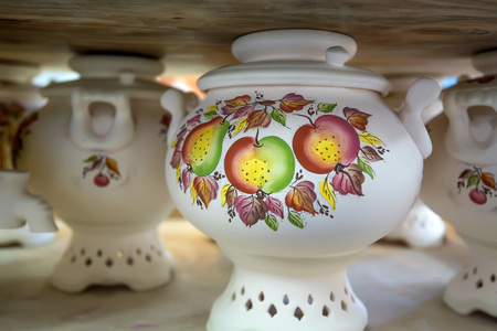 White painted earthenware samovars Stock Photo