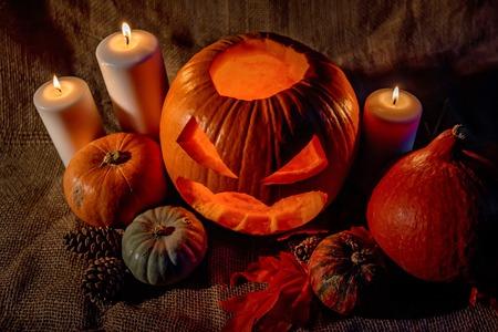 Halloween pumpkin head with burning candles Stock Photo