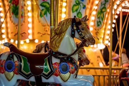 Carousel at fun fair Stock Photo
