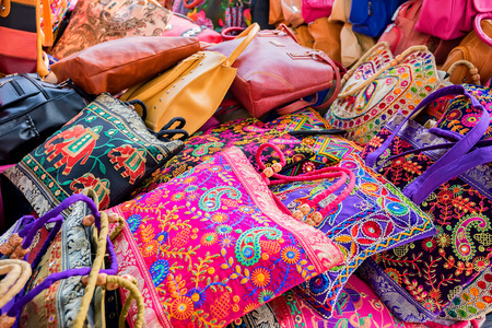 Range of colorful ethnic bags on Indian market